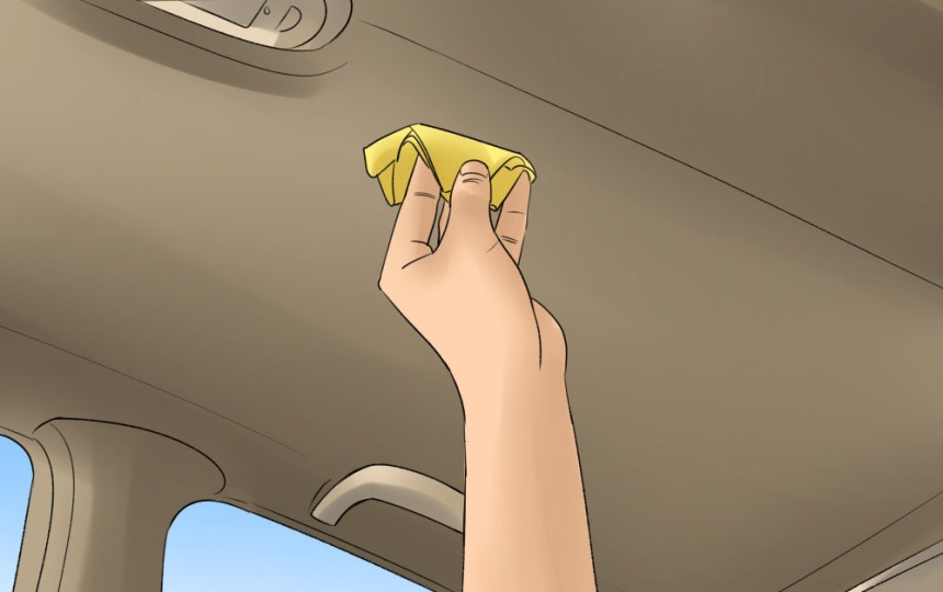 3 - How to Clean the Interior Roof of a Car - person wiping roof with a small microfiber cloth in hand.jpg